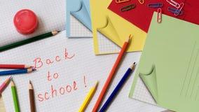 As fontes de escola no caderno cobrem em uma gaiola Fotografia de Stock Royalty Free