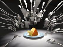 As forquilhas atacam um queijo Fotografia de Stock Royalty Free