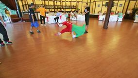 Breakdancer shows his breakdance skill on a dance floor stock video