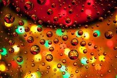 As gotas abstratas da textura do fundo da água e da arte iluminam-se em glas Fotografia de Stock Royalty Free