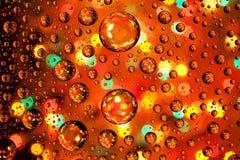 As gotas abstratas da textura do fundo da água e da arte iluminam-se em glas Fotos de Stock Royalty Free