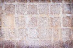 As grandes pedras do bloco resistiram à textura da parede, fundo abstrato dos testes padrões naturais fotografia de stock