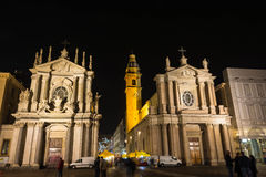 As igrejas gêmeas em San Carlo Square na noite, Turin Foto de Stock