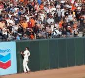 As imprensas do Huff de Aubrey na parede como o homerun são batidas Foto de Stock