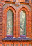 As janelas velhas da igreja fecham-se acima Foto de Stock