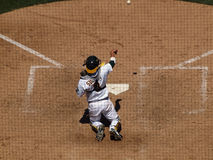As Kurt Suzuki throws the ball back to the pitcher Stock Images