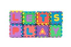 As letras de deixam o jogo feito pelo enigma de serra de vaivém do alfabeto Imagens de Stock