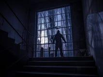 Creepy silhouette of man from low sun through windows royalty free stock photos