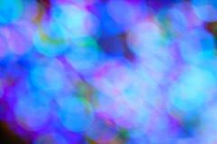 As luzes coloridas do feriado criam Bokeh azul Fotografia de Stock
