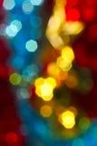 As luzes de Natal borraram a imagem, amarelo, azul, vermelho Fotografia de Stock Royalty Free