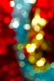 As luzes de Natal borraram a imagem, vermelho azul brilhante, amarelo Fotos de Stock Royalty Free
