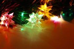 As luzes de três estrelas fazem o cartão perfeito do feriado fotografia de stock royalty free