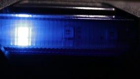 As luzes do diodo emissor de luz estão brilhando através do vidro azul vídeos de arquivo