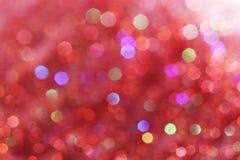 As luzes suaves vermelhas, cor-de-rosa, brancas, amarelas e de turquesa abstraem o fundo - cores escuras Imagem de Stock