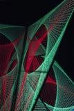 As luzes vermelhas e verdes criaram a formação 3D no preto Fotos de Stock