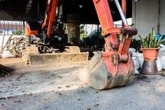 As máquinas escavadoras pequenas alaranjadas Imagens de Stock Royalty Free
