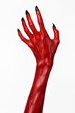 As mãos com pregos pretos, mãos vermelhas de Satã, tema de diabo vermelho de Dia das Bruxas, em um fundo branco, isolado Fotos de Stock Royalty Free