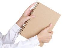 As mãos da mulher que guardam um livro Imagem de Stock