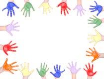 Mãos pintadas para um quadro Imagem de Stock Royalty Free