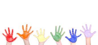 Mãos pintadas para uma beira Fotos de Stock Royalty Free