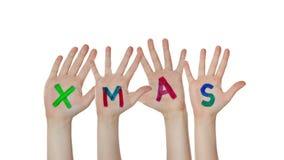 As mãos das crianças que aumentam acima com símbolos pintados do Natal video estoque