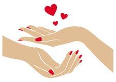 As mãos das mulheres com corações ilustração royalty free