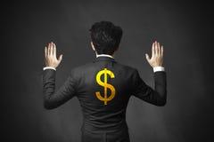 As mãos de levantamento do homem de negócios prenderam acima o dólar Foto de Stock Royalty Free