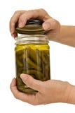As mãos de mulher mais idosa que abrem o frasco de vidro Fotografia de Stock Royalty Free
