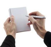 As mãos do homem que guardaram o caderno e a pena Fotos de Stock