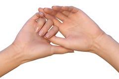 As mãos fêmeas acima levantadas estão guardando a um dos polegares Imagem de Stock