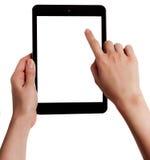 As mãos fêmeas que guardam uma tabuleta tocam no computador com Fotos de Stock