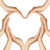 As mãos fazem a forma do coração Imagem de Stock