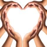 As mãos fazem a forma do coração imagens de stock