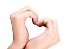 As mãos no coração dão forma, amam imagens de stock