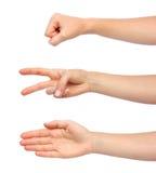As mãos que fazem a rocha scissors o papel Fotografia de Stock Royalty Free
