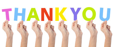 As mãos que mostram a palavra colorida agradecem-lhe Fotografia de Stock Royalty Free