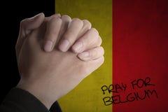 As mãos rezam para Bélgica com bandeira belga Imagens de Stock Royalty Free