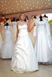 As a mannequin. Young woman in white dress as a mannequin Stock Photography