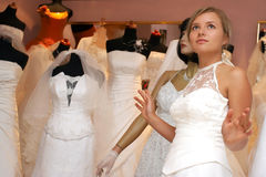 As a mannequin. Young woman in white dress as a mannequin Royalty Free Stock Photo