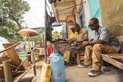 Kenyan shoemaker working in Malindi streets Royalty Free Stock Images