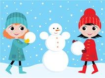 As meninas constroem o boneco de neve Fotos de Stock Royalty Free