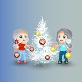 as meninas decoram a árvore de Natal Foto de Stock Royalty Free