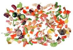 As micro partes pequenas de desperdício de alimento são dispersadas em um kitche branco Fotografia de Stock