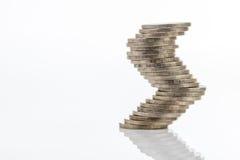 As moedas empilham na posição diferente isoladas Fotos de Stock Royalty Free
