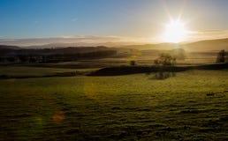 As montanhas de Escócia no inverno frio cancelam o ar do nascer do sol Fotografia de Stock Royalty Free