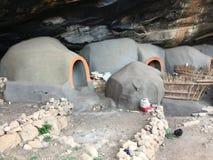 As moradias de caverna de Kome as cavernas de Kome imagem de stock