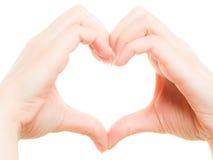 As mãos fêmeas que mostram o coração dão forma ao símbolo do amor Foto de Stock Royalty Free