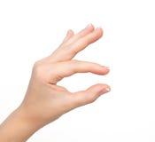 As mostras isoladas da mão da mulher comprimem para zumbir ou guardando o objeto fotos de stock royalty free