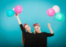 As mulheres como as meninas querem a mosca afastado por balões Imagens de Stock Royalty Free