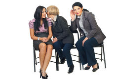 As mulheres de negócio dizem segredos Foto de Stock Royalty Free